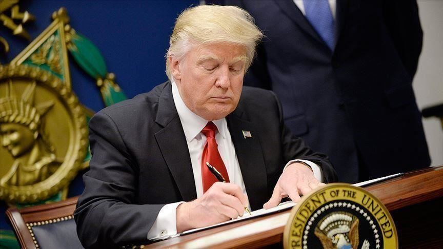 Photo of Trump signs order removing Sudan from terrorism list